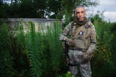 Christian Yingling stands for a portrait in his militia uniform on Monday, Aug. 14, 2017 in his neighborhood in Derry. Yingling is the leader of the Pennsylvania Lightfoot Militia, based out of Latrobe. Yingling's group went down to Charlottesville where they tried to break up and dissolve physical altercations between the two sides, says Yingling, a self-described Constitutionalist.